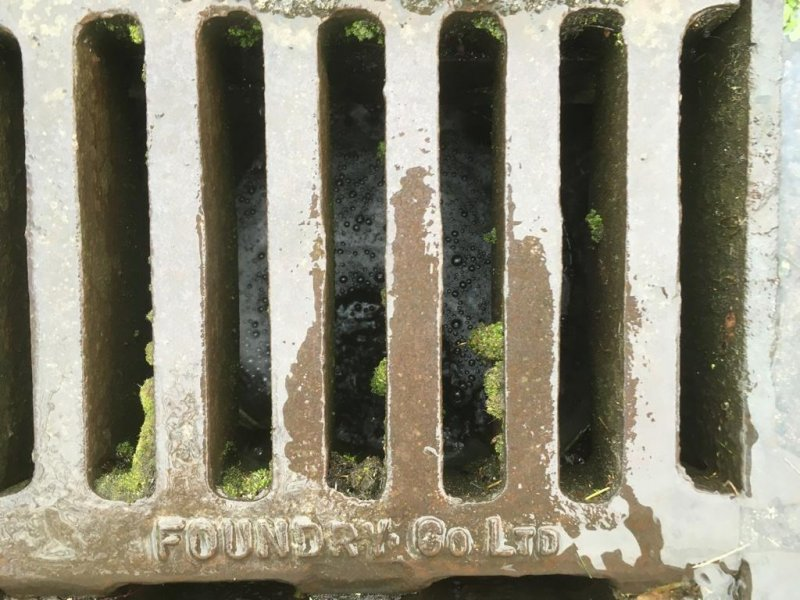 Where the water goes (below) #mbfeb – Storm drain grate in the rain
